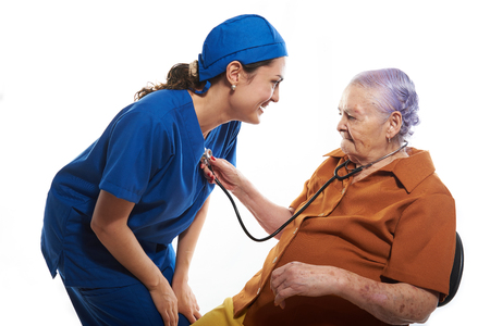 beat: patient checking doctors heart beat with stethoscope Stock Photo