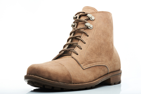 casual wear: stylish light brown men boot from side on white background