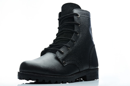 combat: tall black leather men combat boot on white background