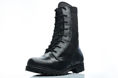combat: tall leather black men combat boot on white background