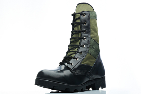 black boots: black and green combat men boot on white background