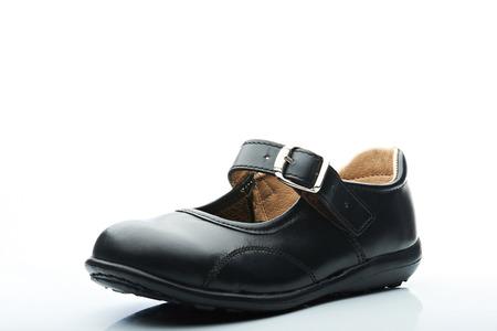 girl kid black leather shoe on white background