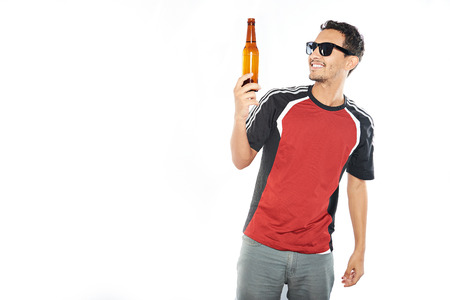 arab young man holding beer bottle isolated on white Stock Photo