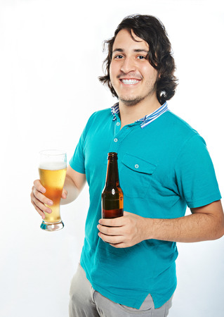latino man: happy  smiling young latino man with beer isolated on white Stock Photo