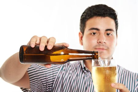 pouring beer: close up of man pouring beer isolated on white