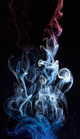 absract: absract coloured swirl on smoke cloud isolated on black Stock Photo