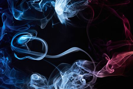 green and purple: colourful smoke frame isolated on black background Stock Photo