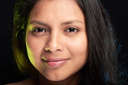 headshot of young girl isoalated on black background