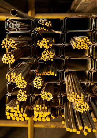 different shape of yellow iron rods in storehouse