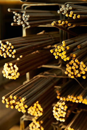brass rod: close up of yellow iron rods in storehouse Stock Photo