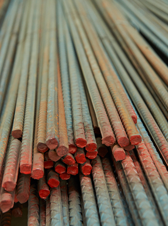 aluminum rod: close up of rusty metal rods in warehouse