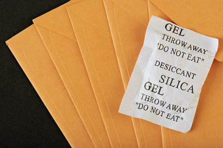 envelop: silica gel package lay on yellow envelop