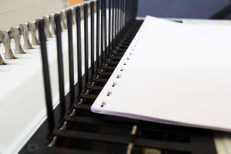 process of making in office equipment bookbinding paper and books.