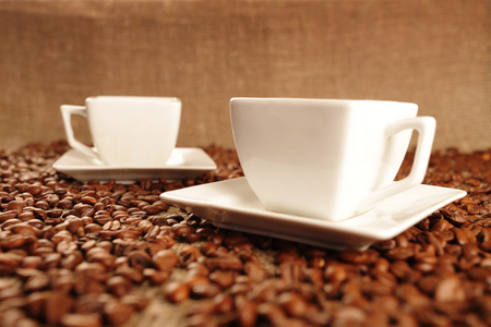 coffee cups: Cups with tasty coffee and coffee beans Stock Photo