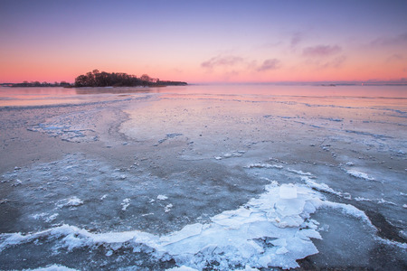 ice covered: Cold winter sunset on the ocean with ice covered ocean