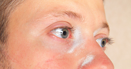 irritation: Skin and eyes irritation of young man after  repairs Stock Photo