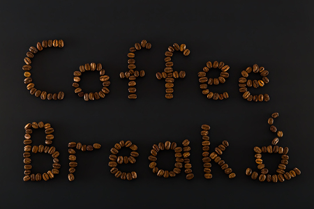 consist: Coffee break words  and cup consist  of brown coffee beans Stock Photo
