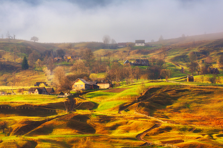 Carpathians contryside landscape panorama of autumn mountains valley fog