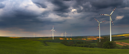 panoranic view on wind  power plant on green field