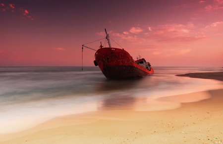 Ship after wreck on the coast with smooth water