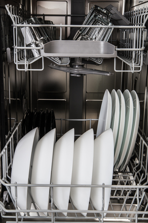 Clean dishes after washing in dishwasher machine