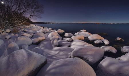 polar station: Winter night on the ocean. Night sky full of stars