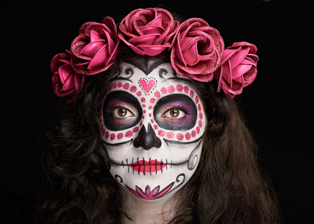 nice makeup for halloween of skull on woman face