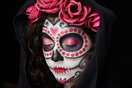 catrina skull with closed eyes isolated on black background