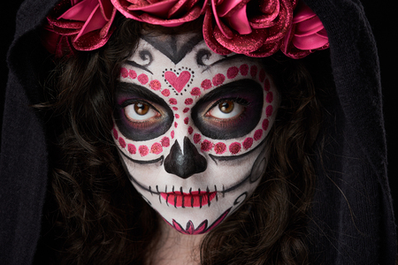 close up of make up skull on woman face with mantle