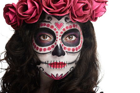 bright halloween makeup on woman face of skull isolated on white