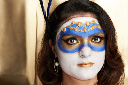 bodypainting: headshot of woman with mask painted on face Stock Photo