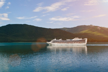 cruise ship in alaska destination landscape in sunny day