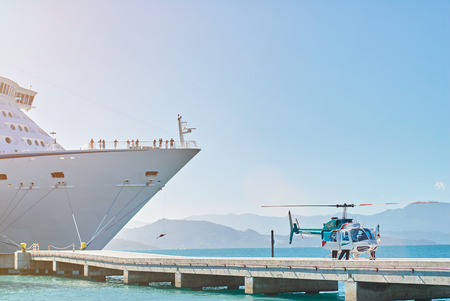 critical care: helicopter take off from emergency in cruise ship on pier