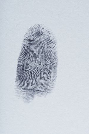 One finger print on white paper close up Stock Photo