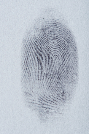 Indentification finger print on white paper texture