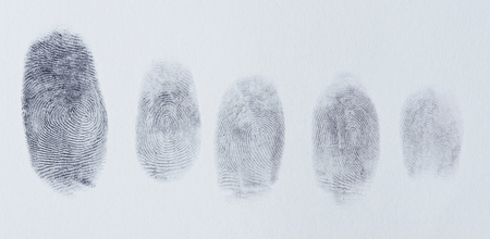 Group of finger prints on white paper texture Stock Photo