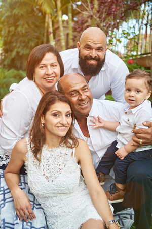 Portrait of hispanic big family in green sunny park