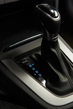 light transmission: Automatic transmission stick with blue light of modern sedan car closeup