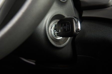 Ignition key of modern car close up. Car key in keyhole Imagens