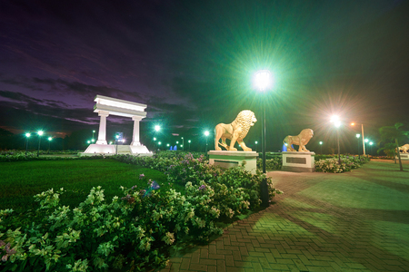 maximo: Leon, Nicaragua - January 4, 2017: Ruben Dario park with flowers and lions in sunset time
