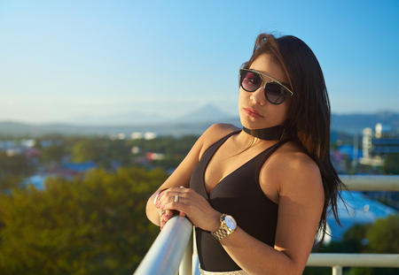 glamur: Glamur girl with sunglasses and gold watch on city background