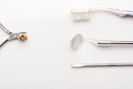 extracted: Cavity on extracted teeth brush,tools isolated on white background Stock Photo