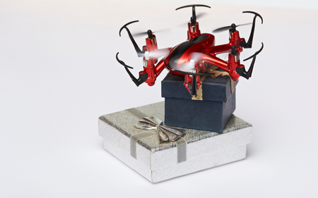 package sending: Gift delivery with drones isolated on white background. Present boxes ship by air drone Stock Photo