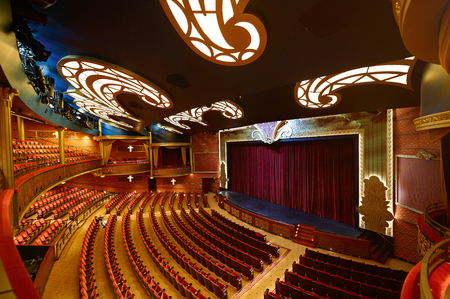 Orlando, USA - April 27, 2015: Theater in disney cruise line ship. Interior of modern colorful theater