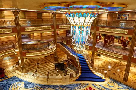 Orlando, USA - August 24, 2014: Main lobby in disney cruise ship. Empty staircase on Disney Dream cruise ship Editorial