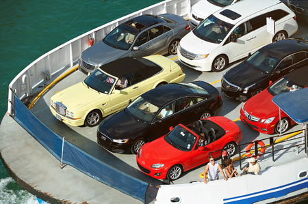 Miami USA - April 27, 2013: Ferry carry parked colorful cars view from top. Delivery car via ship