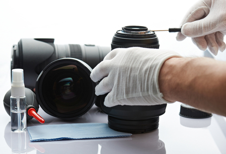 Closeup of repairing photography lens isoalted on white background. Repair lens service desk Stock Photo