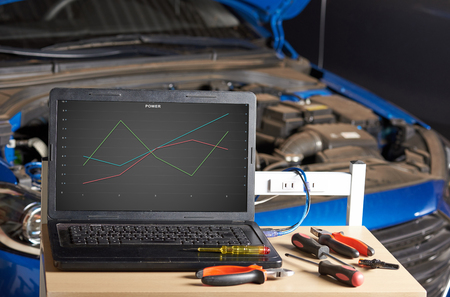 Station for computer checking car. Diagnostic of modern car