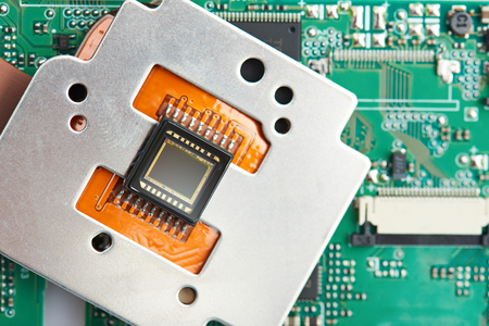 Closeup of small digital camera sensor on electronic circuit background