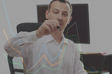 Colorful chart concept with business man in office background